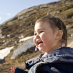 Inuit Child in the Snow, Baffin Island, Nunavut, Canada.